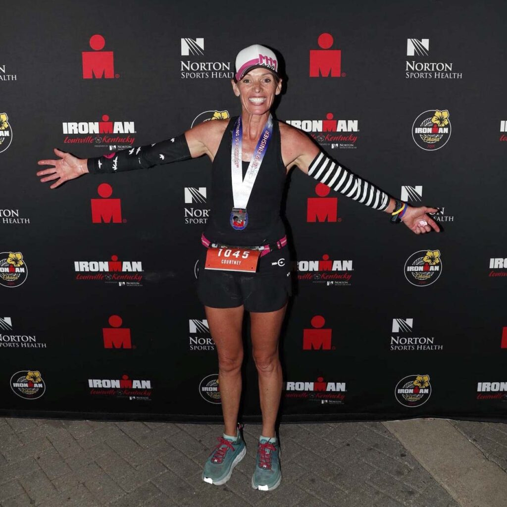 Courtney Culligan at the finish of an Ironman