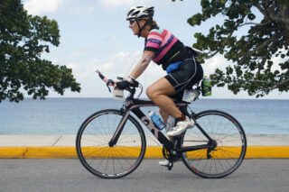 Cynthia riding her bike in a triathlon race